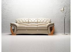 靠着墙壁的白色沙发