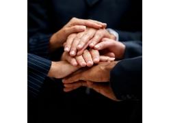 手放在一起的商务团队