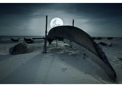 夜晚沙滩的小船图片