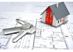 图纸上的钥匙与房屋模型