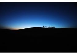 黄昏大漠骆驼商队