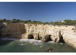 海岸岩洞风景摄影图片