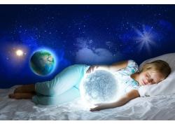 地球日月星辰和睡觉的女孩图片