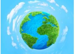 绿色地球和白云背景